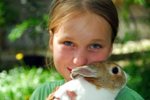 Pet Honoring Girl and bunny